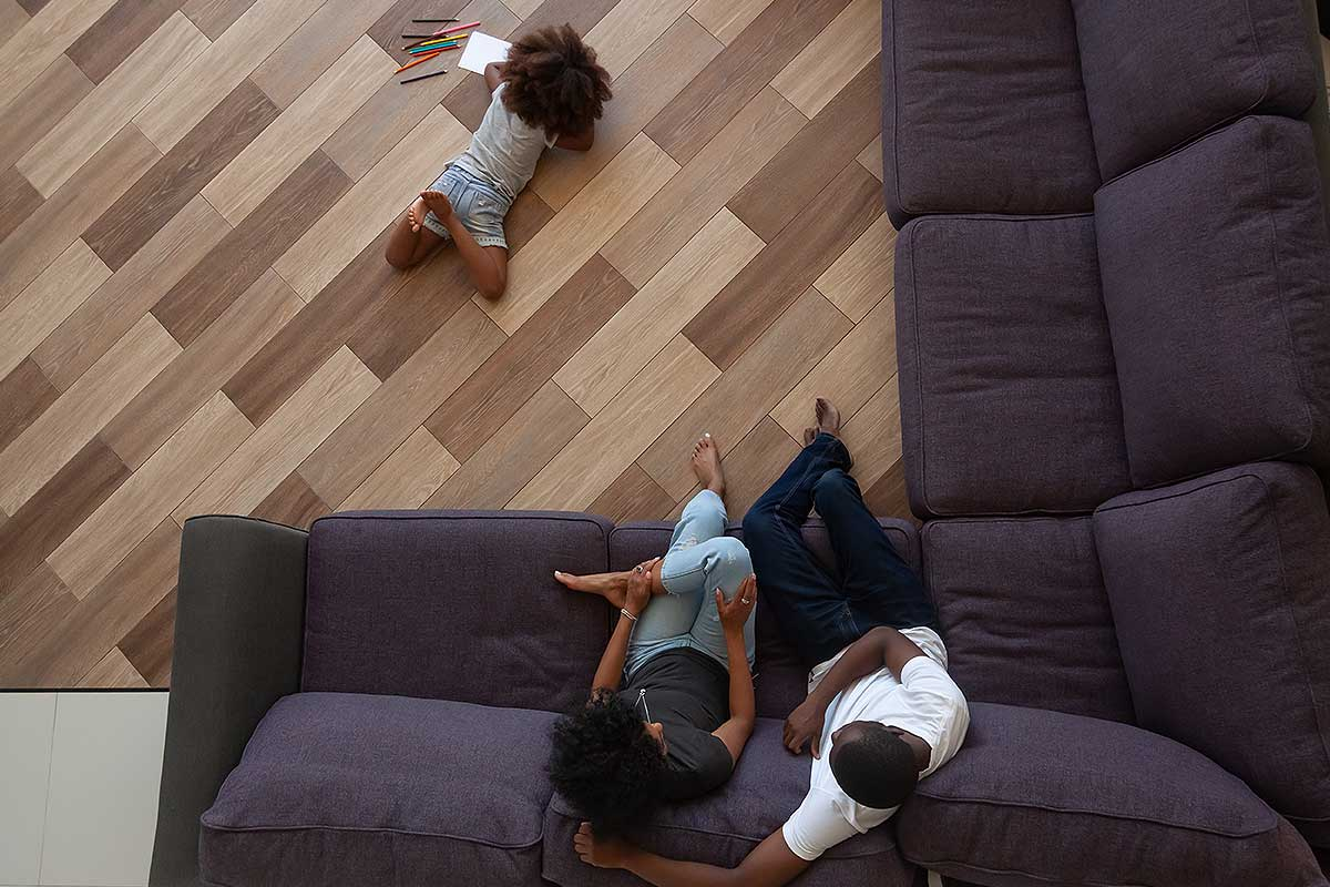 Homeowners Comprehensive Insurance (Bird's eye view image of a couple seated on a couch)
