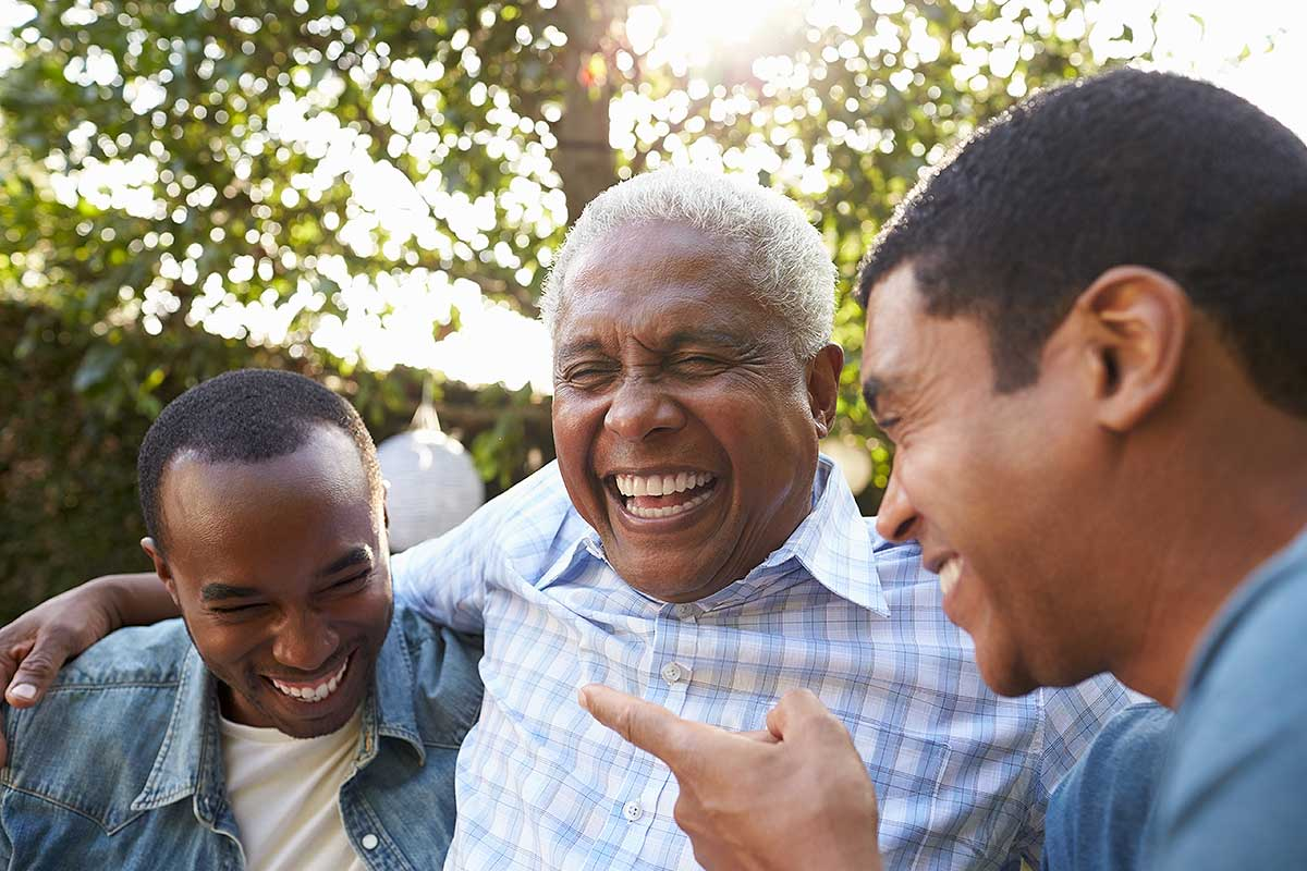 Group Credit Life Assurance (Image of a elderly man with his two sons)
