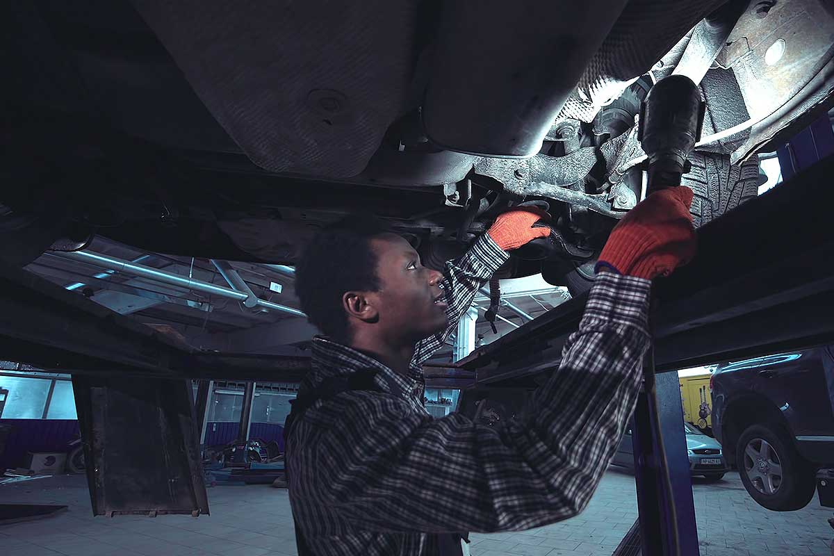 Motor Private Insurance (Image of a mechanic repairing a vehicle)
