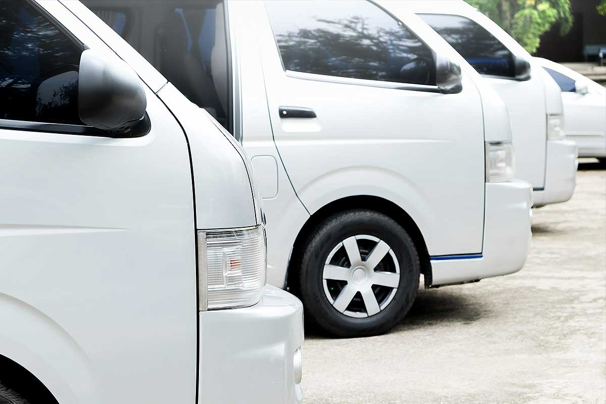 Institutional Vehicles (image of white mini vans parked in a row)