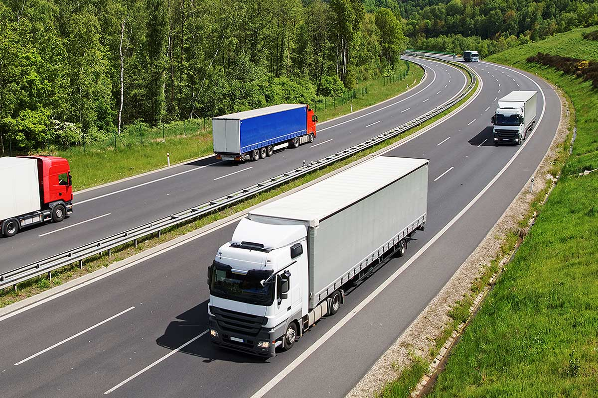 Motor Commercial Insurance (Image of trucks on a dual carriageway)