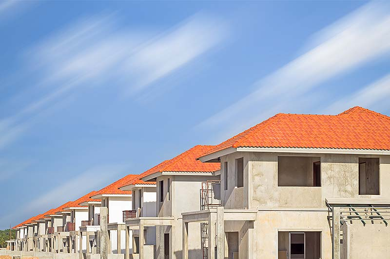 Estate Development (Image of a row of identical houses under construction)