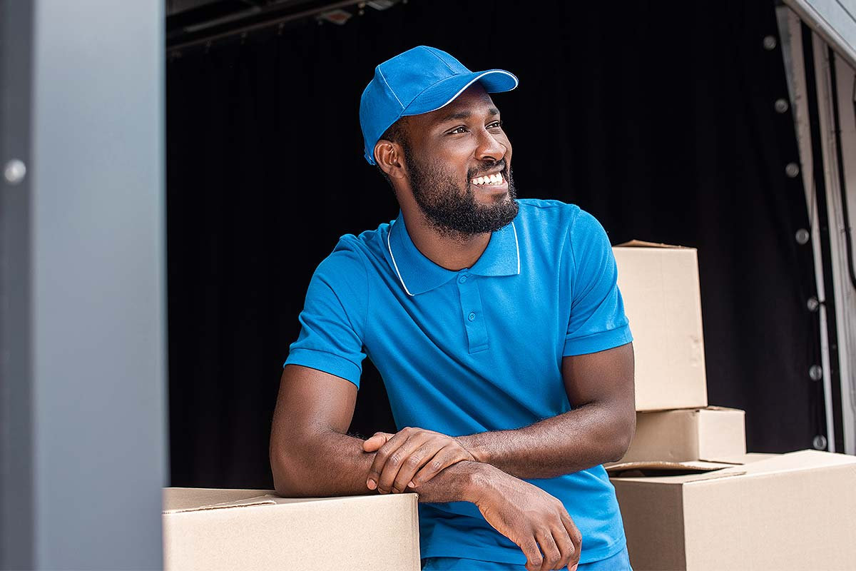 Local Purchase Order Financing (Close up of a delivery man next to stacked boxes)