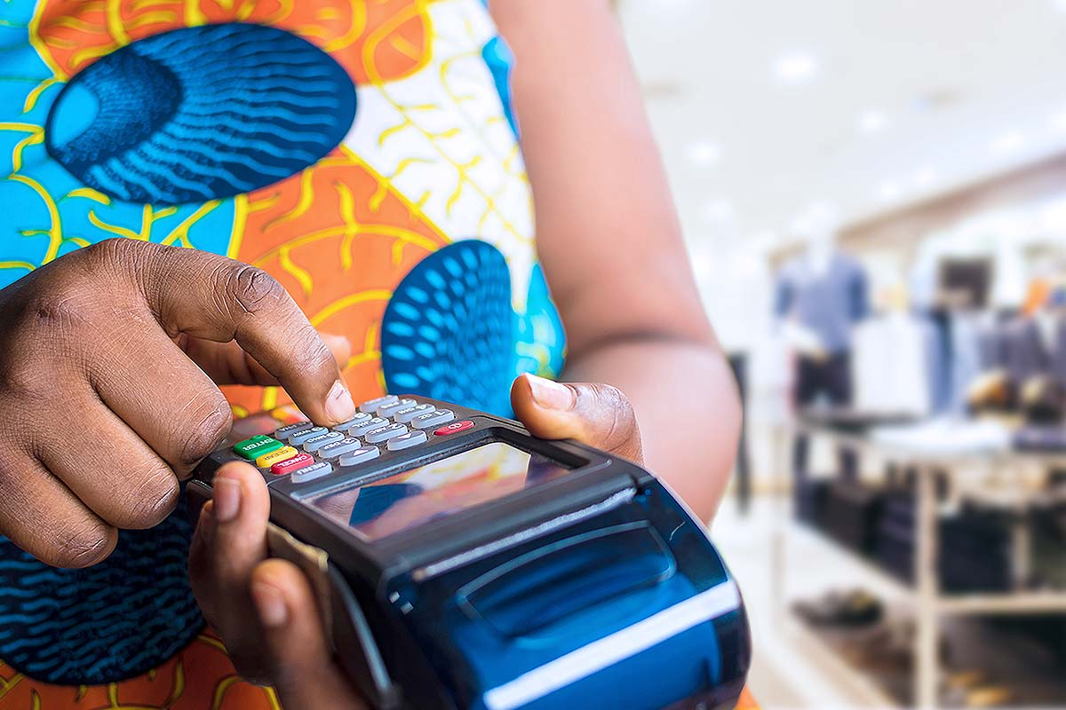 Point of Sale (Close-up of a lady using a POS terminal)