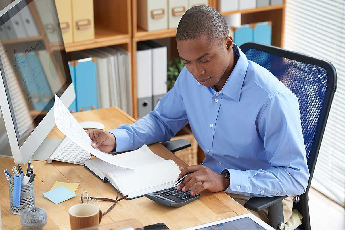 Shareholder Information (image of a young man looking over financial documents)
