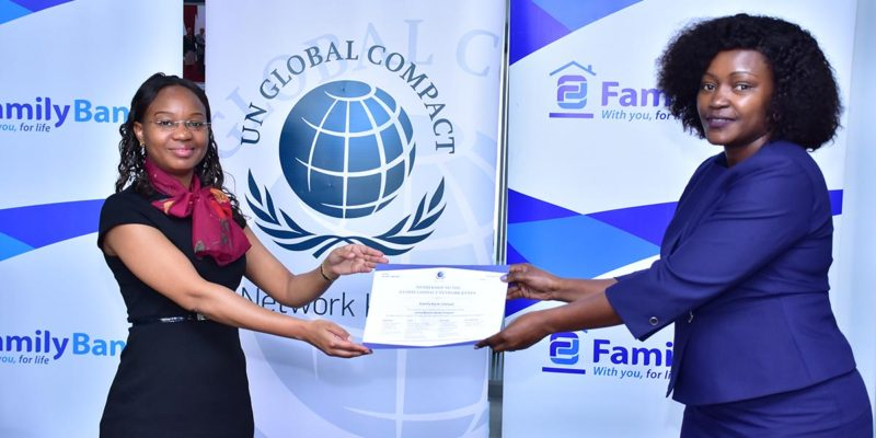 UN Global Compact Kenya Network Executive Director Judy Njino hands over the membership certificate to Family Bank CEO Rebecca Mbithi